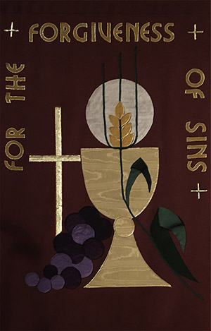 church banner depicting a chalice and cross